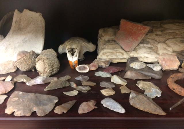 image of Various arrow heads and cultural artifacts